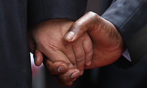 The Chinese president, Xi Jinping (left), holds the hand of Robert Mugabe upon his arrival in Harare in December 2015.