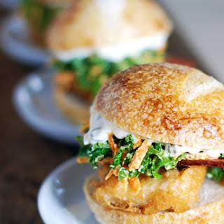 Crispy Catfish Sliders with Kale Coleslaw, Caper Mayo, and Crispy Bacon.