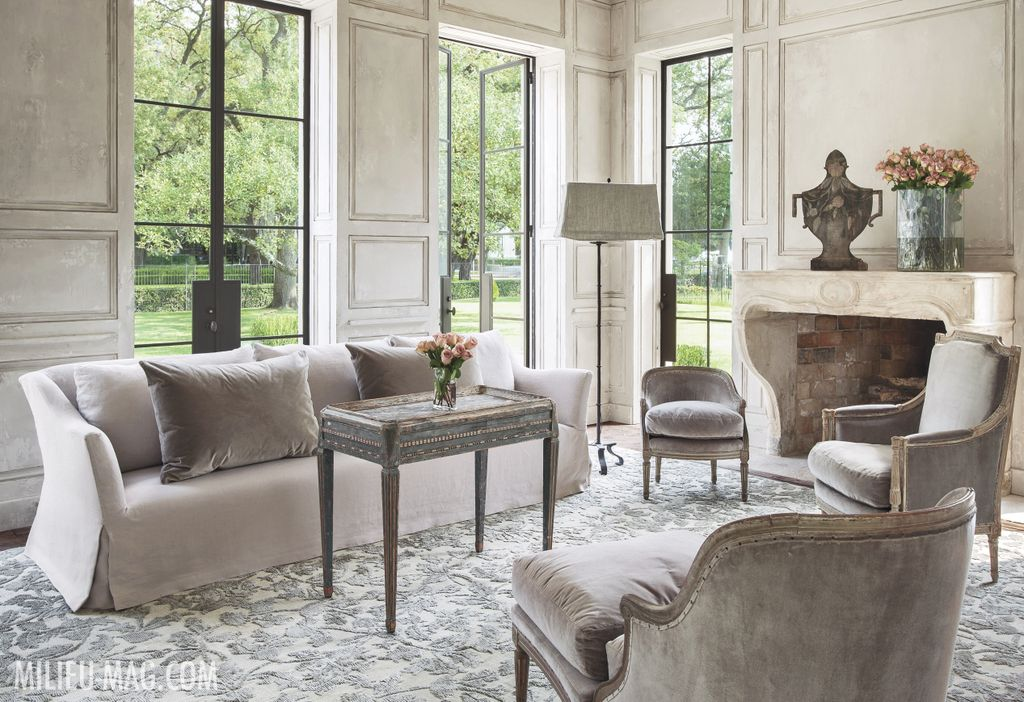 Gorgeous and elegant French inspired living room by Pamela Pierce with neutrals, stone fireplace, velvet and French antiques. #livingroom #PamelaPierce #frenchlivingroom #limestonefireplace