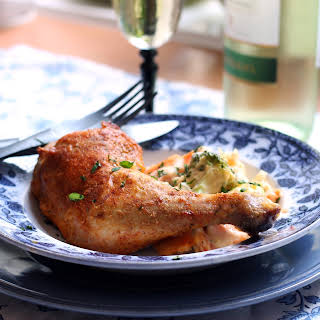 Creole Seasoned Baked Chicken with Vegetable Gratin.