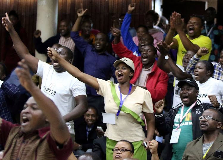Delegates celebrate after Zimbabwean President Robert Mugabe was dismissed as party leader at an extraordinary meeting of the ruling Zanu-PF's central committee in Harare, Zimbabwe, on November 19, 2017. Picture: REUTERS