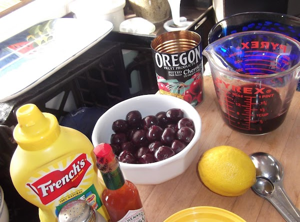Drain syrup from cherries into a 2-cup measure; add water to make 1-1/2 cups....