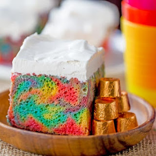 Rainbow Poke Cake With Whipped Cream.