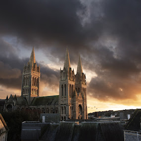 Truro Cathedral at sunset by Aaron Nappin - Buildings & Architecture Places of Worship ( building, sunset, city center, dramatic, cloud, cornish, cathedral, architecture, birds, cornwall, city, rooftops )