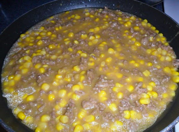 Add to the cooked ground beef one can of corn, liquid and all, and...