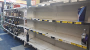 Shelves that were fully stocked this morning are close to empty at the Melville Liquor store in Johannesburg.