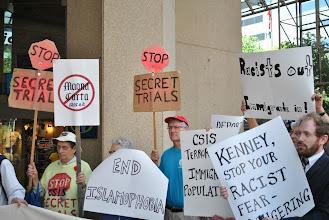 Photo: Placards reading: 'Stop secret trials.'