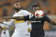 Taariq Fielies of Cape Town City and Mpho Makola of Orlando Pirates during the Absa Premiership match between Orlando Pirates and Cape Town City FC at FNB Stadium on September 19, 2017 in Johannesburg.