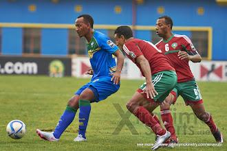 Photo: Hegman NGOMIRAKIZA (20) lays off the 1-2 pass that, when returned seconds later,  allows him to score [Rwanda vs Morocco, CHAN - Group A, 24 Jan 2016 in Kigali, Rwanda.  Photo © Darren McKinstry 2016, www.XtraTimeSports.net]