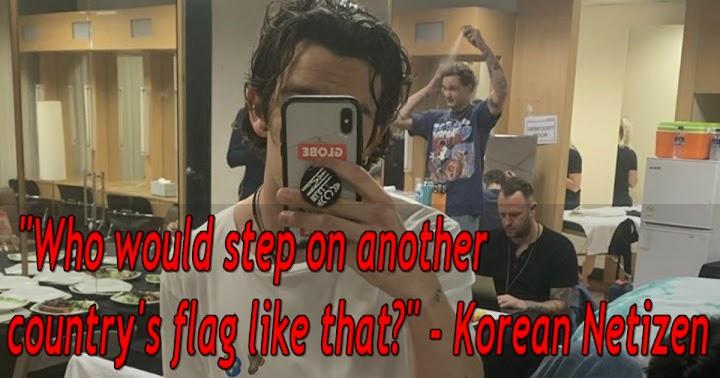 Giọng ca chính của The 1975  Matthew Healy bị ném đá vì chụp ảnh dẫm lên cờ Hàn Quốc ảnh 4