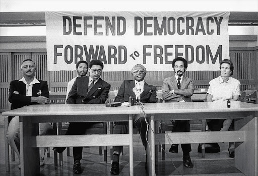 COMRADES IN ARMS: Professor Jakes Gerwel (second from right) with (from left) Frank van der Horst, Lionel Louw, Allan Boesak, Desmond Tutu and Mary Burton at a Defend Democracy campaign at a the height of apartheid repression in the late 1980s Picture: GALLO IMAGES/ORYX MEDIA ARCHIVE