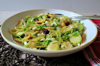 Photo: Sauteed Brussels Sprouts and Apples - A sweet and savory side dish made with sauteed Brussels sprouts, onions and apples that are cooked together in apple juice and topped with dried cranberries.  http://www.peanutbutterandpeppers.com/2012/11/16/sauteed-brussels-sprouts-and-apples/  #brusselsprouts   #apples   #sidedish   #vegetarian   #fallrecipes