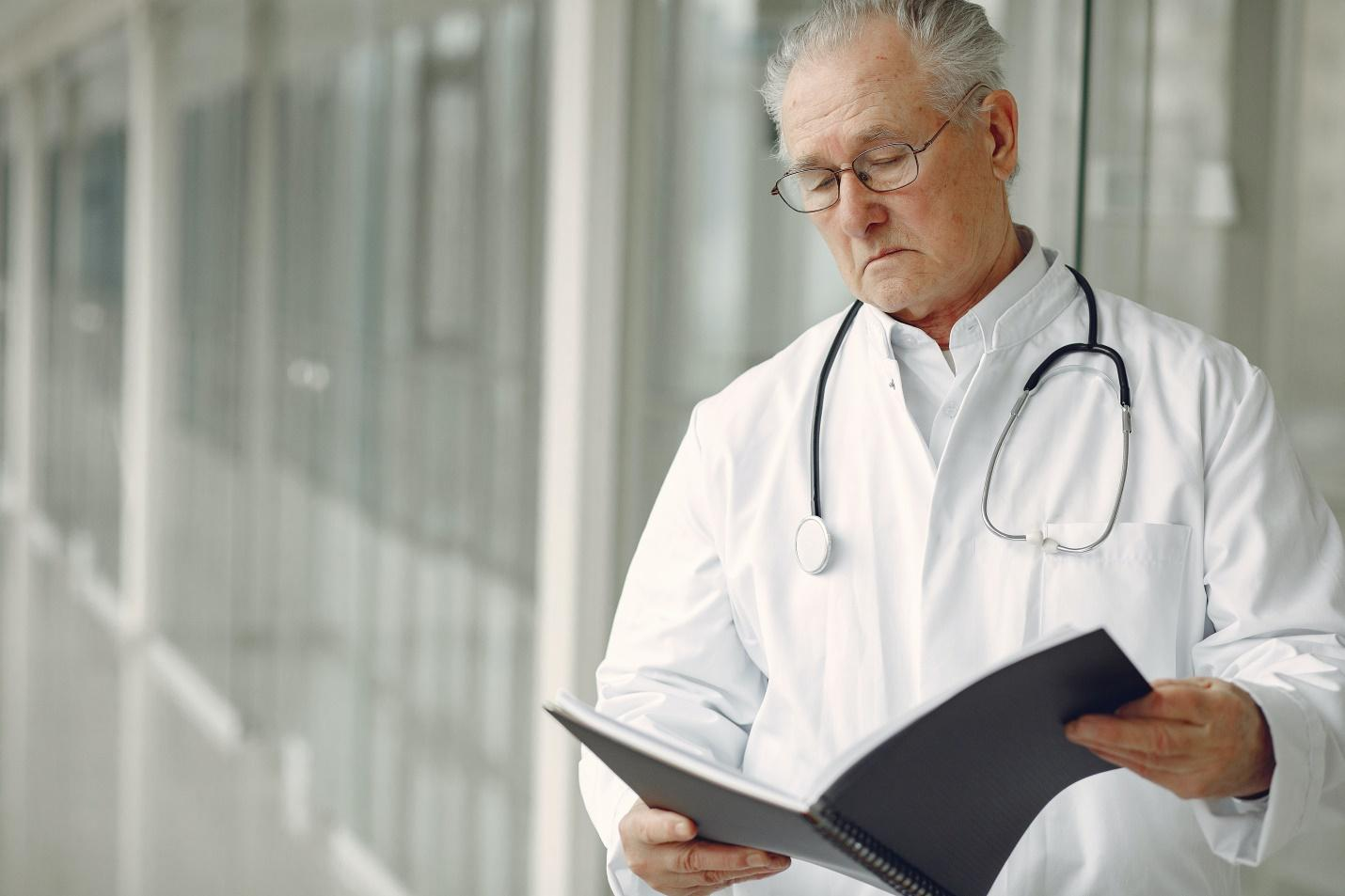 A physician reading patient records