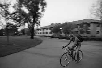 Photo: Requirement 3:  I wanted to give the feeling of motion by panning with the bicyclist through the shot.  The comparatively low exposure time + panning let me capture the biker but blur the background.  Random fact: Right after this, a LARGE raccoon ran and climbed up into the tree in the middle.