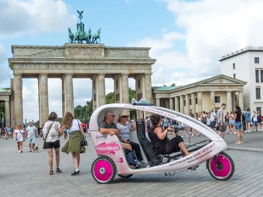 pedicab-in-berlin.jpg -   A pedal-powered pedicab picks up some tourists at Brandenburg Gate in Berlin.