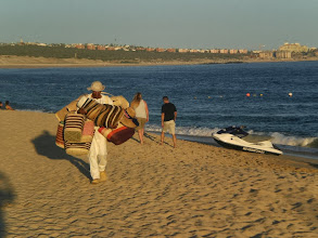 Photo: Selling hats and baskets on the beach, Cabo San Lucas