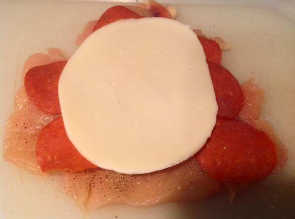 Place one slice of Provolone Cheese on Salami or Pepperoni.