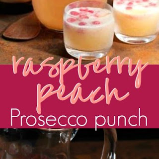Sparkling and Sweet Raspberry Peach Prosecco Punch.
