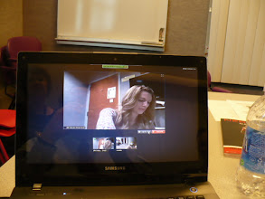 Photo: First Telepractice speech therapy session in progress utilizing laptop and desktop computers.