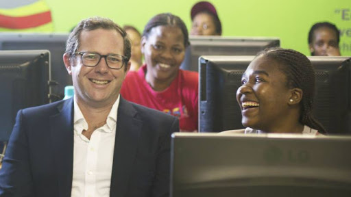 Edward Lawrence, Director and Founder of Workonline Communications with Afrika Tikkun learners