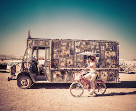 Photo: Guess the Burning Man Camera Trivia Contest - Photo #4  (more on the contest at http://goo.gl/96uST )  Which camera do you think was used to make this photo?  A – The Olympus Tough TG-1 – $369 B – The Pentax Optio WG-2 – $299 C – The Pentax K-01 – $546 D – The Sony NEX-7 – $1348 E – The Nikon D3S – $4499 (note that I kept my Nikon D800 in the trailer the whole time and never used it… ) F – The Phase One – Over $10,000  Caption for photo below: A girl rides by this most amazing truck... where do you think it came from?   ANSWERS:  1 - F 2 - A 3 - C 4 - B 5 - D 6 - E