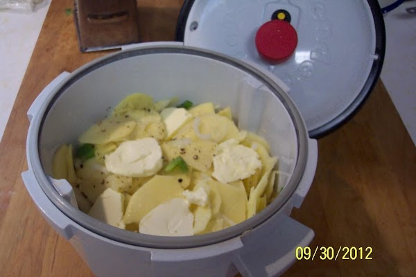 Layer 1/2 of the potatoes, onions,green pepper in the Tender Cooker. Sprinkle with  half...