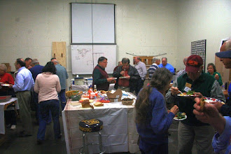 Photo: We began this Holiday party with a very tasty potluck, and everyone was happily engaged in conversations.
