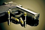Generic photo of a gun and bullets