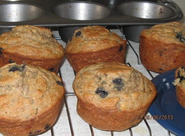 Mash bananas and measure blueberries and stir into the batter. Using a soup ladle, scoop...