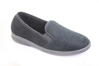 Black mens slipper with a velour top and hard plastic sole. Made in Spanish working conditions.