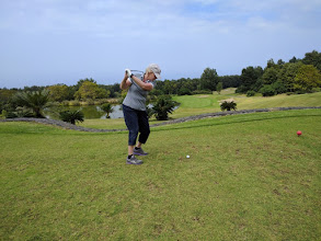 Photo: Linda Lewis teeing off on the Makalei Golf Club course, a hilly, forested course with lots of wildlife at about 2200 feet elevation.