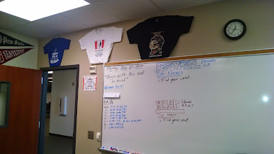 "Photo: Quote of the Day, date, bells, and ""Do Nows"" in the front on the board. Above the board are some of our past AP T-Shirts."