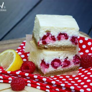 Lemon Cheesecake Bars with Raspberries.