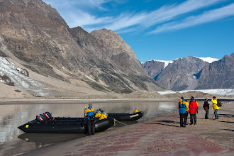 Photo: A trip ashore to try to reach the glacier that can be seen in the distance. We didn't quite make it; there were too many rivers impeding our progress. Note the rifle being carried in case we encountered polar bears.