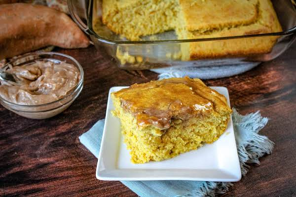 A Slice Of Sweet Potato Cornbread With Cinnamon Honey Butter On A Plate.