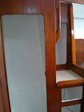 Photo: Starboard salon lockers after painting the interior's white