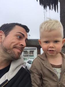 Man looking at his toddler son