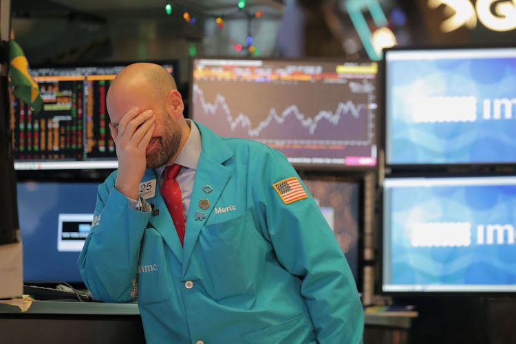 A trader on the floor at the New York Stock Exchange in New York City, New York, the US, on December 4 2018. Picture: REUTERS/BRENDAN MCDERMID