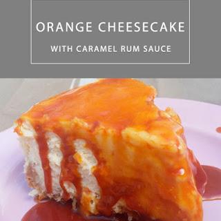 Orange Cheesecake with Caramel Rum Sauce