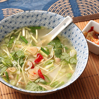 Easy Chicken and Ginger Soup With Rice Cakes, Chives, and Quick-Pickled Garlic.