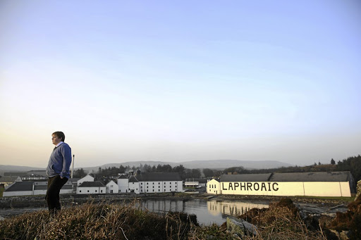 Giving a dram: The Laphroaig whisky distillery is perched at the sea's edge on the Hebridean island of Islay, Scotland. The tiny island, famed for its peated whiskies, is home to eight distilleries. Picture: REUTERS