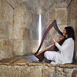A street musician in Jerusalem. by Marcel Cintalan - City,  Street & Park  Street Scenes ( jerusalem, street, musician, izrael, scene )