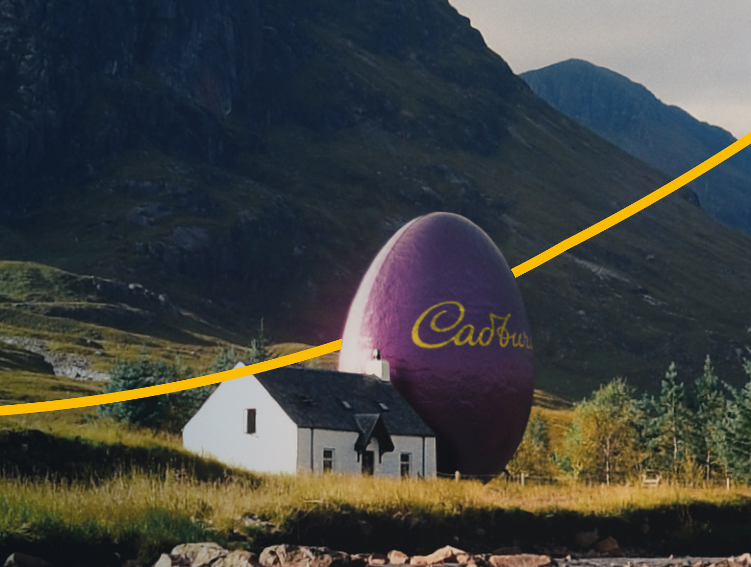 A gigantic Cadbury Egg next to a house in the countryside