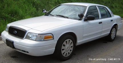 Photo: Lot 25 - (3175-1/1) - 2011 Ford Crown Victoria - 100,143 miles