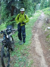 Photo: Pete Basinger on the climb to Georgia Pass. Full conditions--hail and rain.