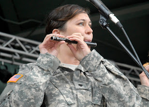 Photo: Spc. Shannon Kroenke plays the piccolo during the 34th Red Bull Infantry Division Band's performance at the Minnesota State Fair's Military Appreciation Day Aug. 30, 2011 in St. Paul, Minn.
