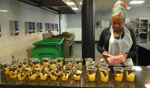 Frutee Belliez co-owner prepares fresh fruit salad, smoothies and vegetables.