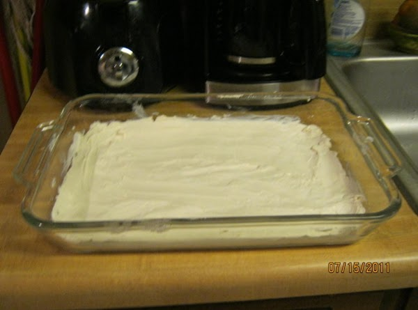 Spread cream cheese evenly on bottom of 9x13 in baking pan.