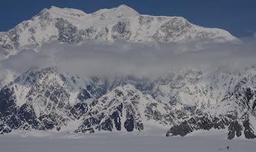 Photo: Tomek pulling sled (righ low corner) and Mount Logan 20 km away.