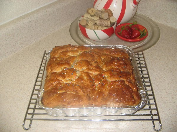 Remove from oven to wire cooling rack. Brush top with butter and cool completely...